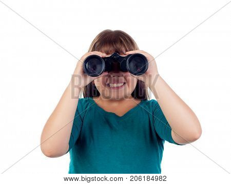 Happy girl looking through a binoculars isolated on a white background