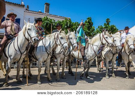 Sent-Mari-de-la-Mer, Provence, France - May 25, 2015. The concept of ethnographic tourism. World Festival of Gypsies. Escorts - security guards on white horses before the parade