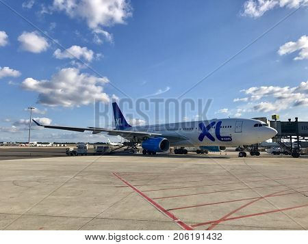 LYON - SEPTEMBER 20, 2017: An XL Airways A330-200 aircraft parked on stand at Lyon–Saint Exupéry International Airport in Lyon, France.