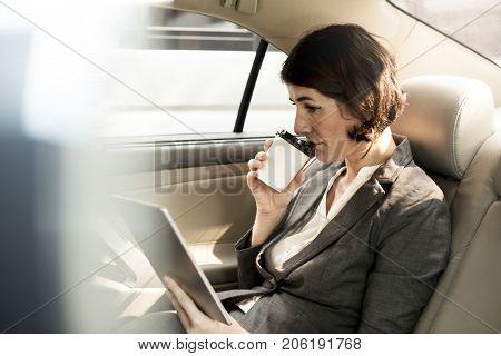 Businesswoman Using Tablet Car Inside