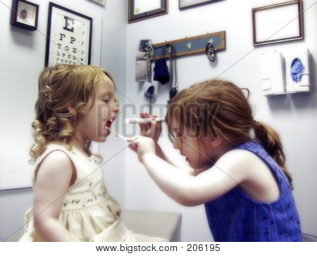 Two Little Girls Playing Doctor