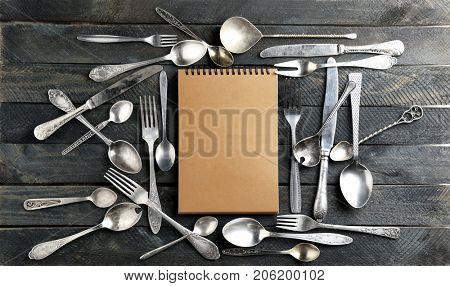 Composition with silverware on wooden background