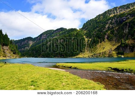 Beautiful mountain landscape with lake. Laqo Lagorai in Dolomite Alps, Val di Fiemme, South Tyrol, Italy.