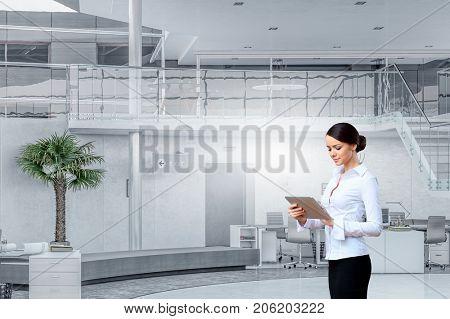 Lady boss use tablet device. Mixed media