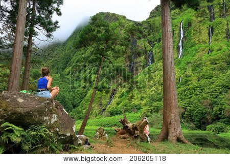 FLORES ISLAND, 12 AUGUST 2017 - Tourists admiring  Pozo da Alagoinha, also known as Pozo Ribeira do Ferreiro, Azores, Portugal, Europe