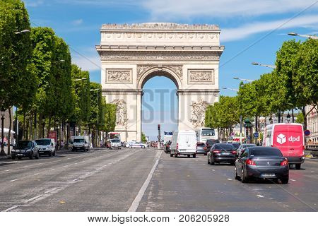 PARIS,FRANCE - JULY 29,2017 : The Champs-Elysees next to the Arc de Triomphe in central Paris on a summer day