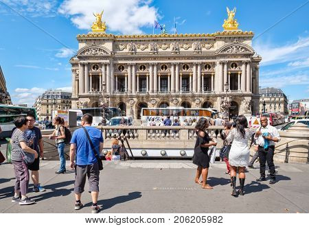 PARIS,FRANCE - AUGUST 3,2017 : Street scene in central Paris next to the Paris Opera or Palais Garnier