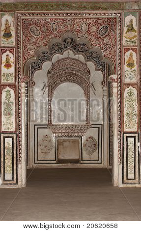 Wall paintings and arches inside Nagaur's palace in Rajasthan.