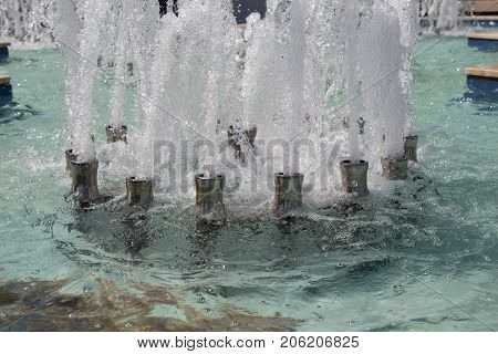 The Fountains Gushing Sparkling Water In A Pool