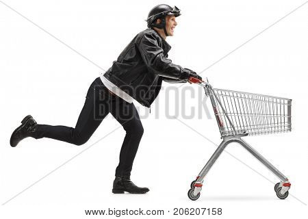 Full length profile shot of a biker pushing an empty shopping cart isolated on white background