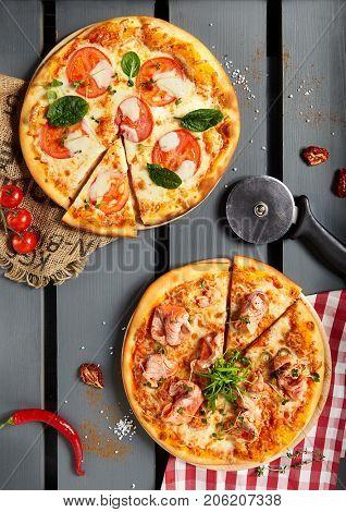 Italian Pizza Restaurant Menu - Margarita and Salmon Pizza. Pizza Dinner. Top View