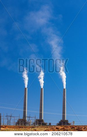 Air pollution from coal-powered plant smoke stacks