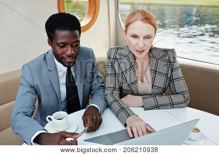 Business associates networking during travel by steamship