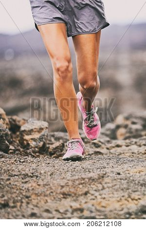 Running shoes sport exercise fitness woman athlete on trail run training on desert path outdoors. Lower body legs closeup hiking on hike nature.
