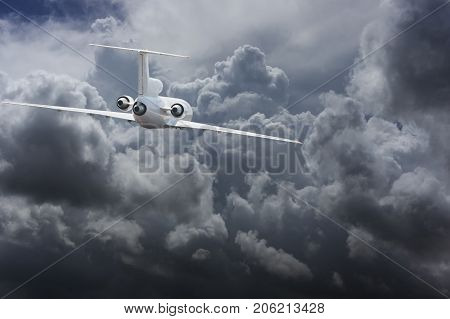 Civil airliner head to heavy thunderstorm clouds