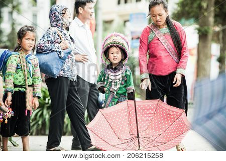 SA PA, VIETNAM - AUGUST 2017: Black hmog ethnic minority people in Sa Pa town, the high mountains, Lao Cai province, Vietnam
