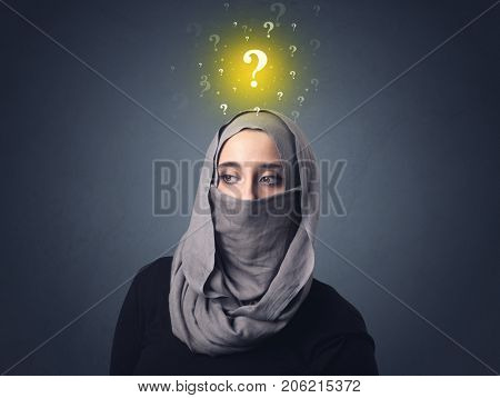 Young muslim woman wearing niqab with yellow question marks above her head