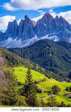 Lovely sunny day in Naturpark Puez-Odle. Dolomites, Val de Funes valley. Odle mountain peaks around the valley
