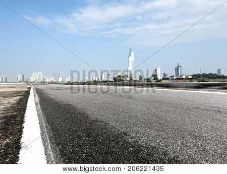 empty asphalt road with cityscape of nanjing in blue sky