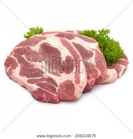 Raw pork neck chop meat with parsley herb leaves garnish isolated on white background cutout
