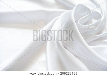 White Shiny Silk Folded With Soft Folds. Matte And Glossy White Fabric.