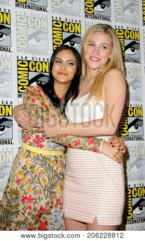 Camila Mendes and Lili Reinhart arrive at the 2017 Comic Con press room at the Hilton San Diego Bayfront hotel on July 22, 2017 in San Diego, CA.