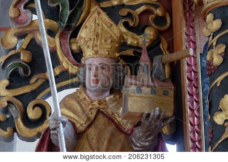 VUKOVOJ, CROATIA - OCTOBER 08: Saint Ambrose statue on the main altar in the chapel of St. Wolfgang in Vukovoj, Croatia on October 08, 2016.