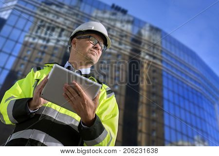 Construction engineer with tablet