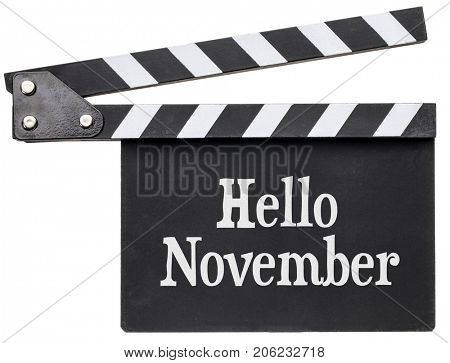 Hello November movie title in white chalk on clapboard isolated on white