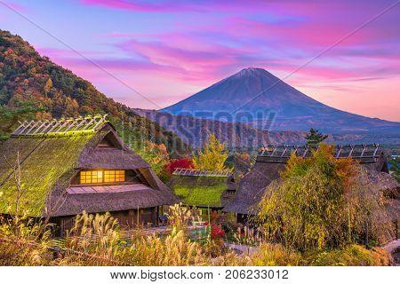 Mt. Fuji, Japan and historic village during an autumn twilight.