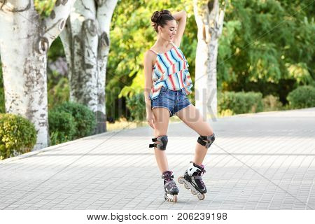 Young woman rollerskating in park