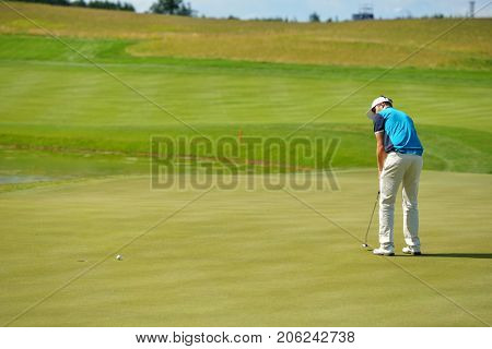 TSELEEVO, MOSCOW REGION, RUSSIA - JULY 24, 2014: Unidentified golfer on the golf course in the Tseleevo Golf & Polo Club during the M2M Russian Open. It is the stage of the European Tour