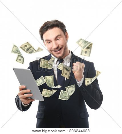 Money flying out of tablet while man using it on white background