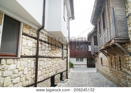 Picturesque narrow street with balconies on both sides