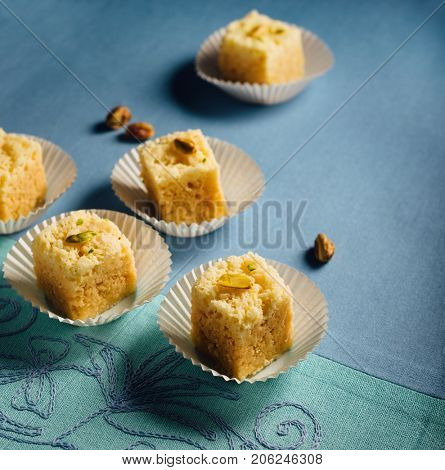 Mysore Pak- an Indian tradtiinal sweet made with gram floor, sugar and ghee garnished with pistachio.