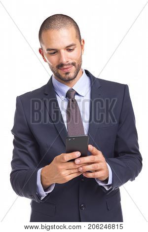 Businessman sending message in his smartphone, isolated on a white background
