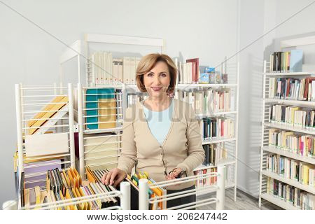 Senior librarian working at school library