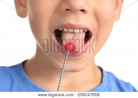 Cute boy with logopedic probe for speech correction on white background, closeup