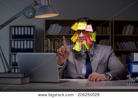 Businessman staying late to sort out priorities