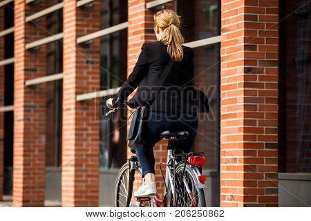 Urban biking - woman riding bike in city