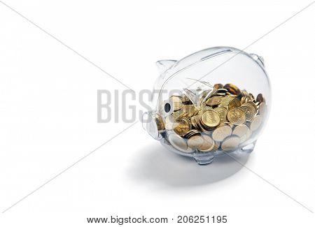 Transparent piggy bank with coins