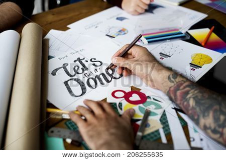 Hands Writing Let's Get It Done Phase on Paper Art Design