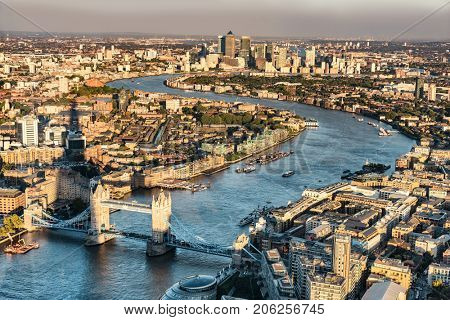 London city skyline aerial view at sunset with The Shard tower shadow, UK, Great Britain. Famous Europe travel destination. Tower bridge and Thames river, popular touristic attractions.
