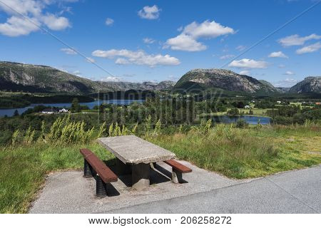 Summer Norwegian landscape with a place for rest. View of the mountains and hills. Sunny day