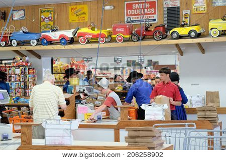 SHIPSHEWANA, INDIANA, USA - MAY 26, 2016: Amish people at checkout counter inside supermarket in Shipshewana, Northern Indiana's Amish Country.