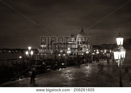 Venice at night with Santa Maria della Salute church and historical architectures in Italy.