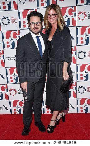 LOS ANGELES - SEP 24:  J.J. Abrams and Katie McGrath arrives for the LGBT Center's Vanguard Awards 2017 on September 24, 2017 in Beverly Hills, CA