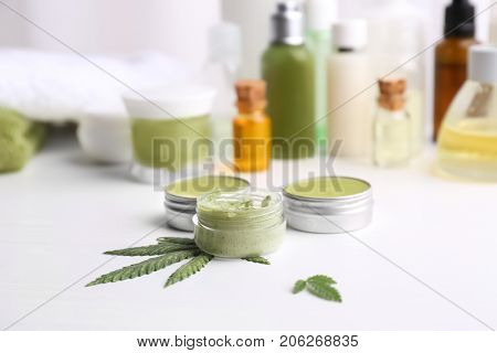 Cosmetics with hemp extract on white table