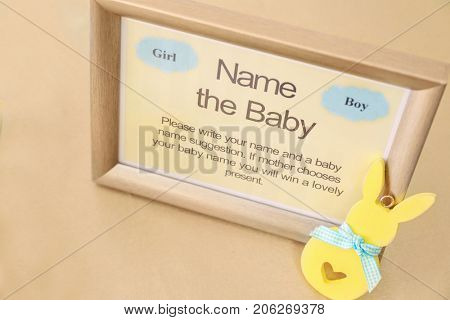 Game for suggestion of baby name on table at shower party
