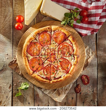 Pizza Restaurant Menu - Delicious Fresh Margarita Pizza with. Pizza on Rustic Wooden Table with Ingredients